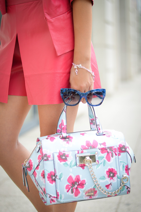 Guess handbag, sunglasses and bracelet worn by Denina Martin