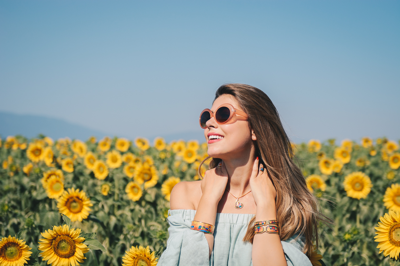 Denina Martin wearing freywille-jewellery around sunflowers