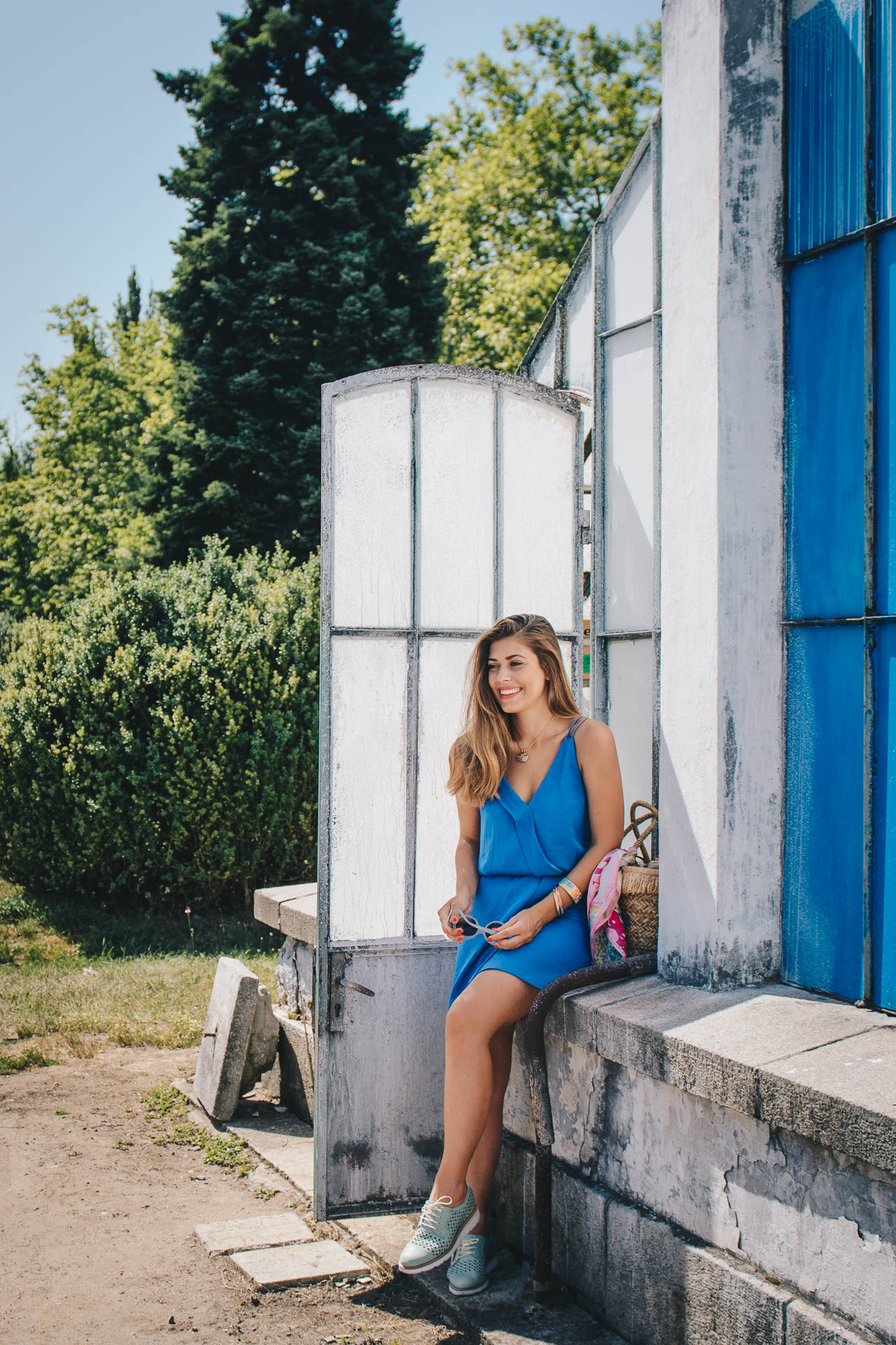Wearing blue midi dress and freywille