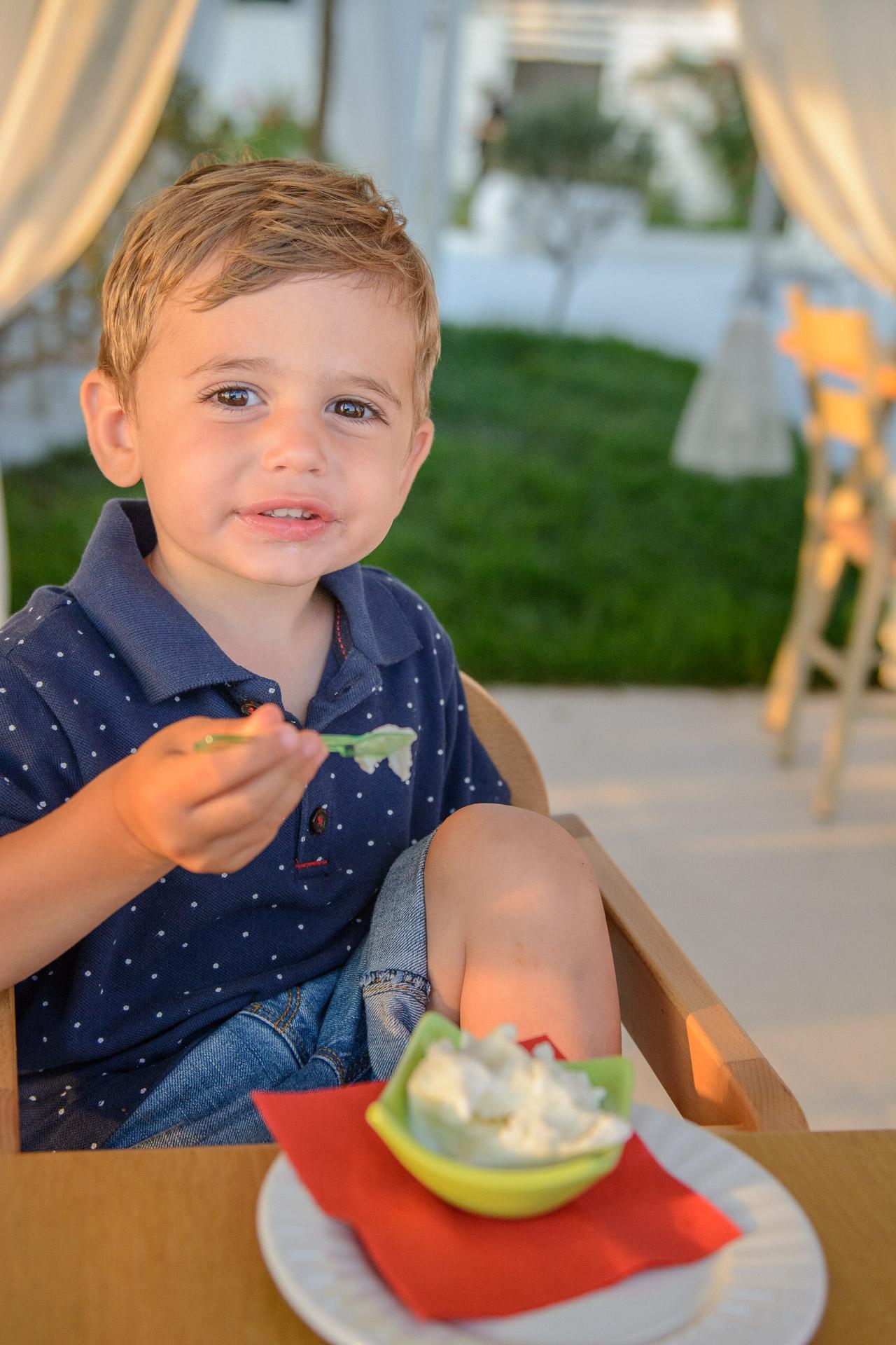 Happy kid eats ice cream