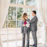Couple wearing H&M Erdem grey suit