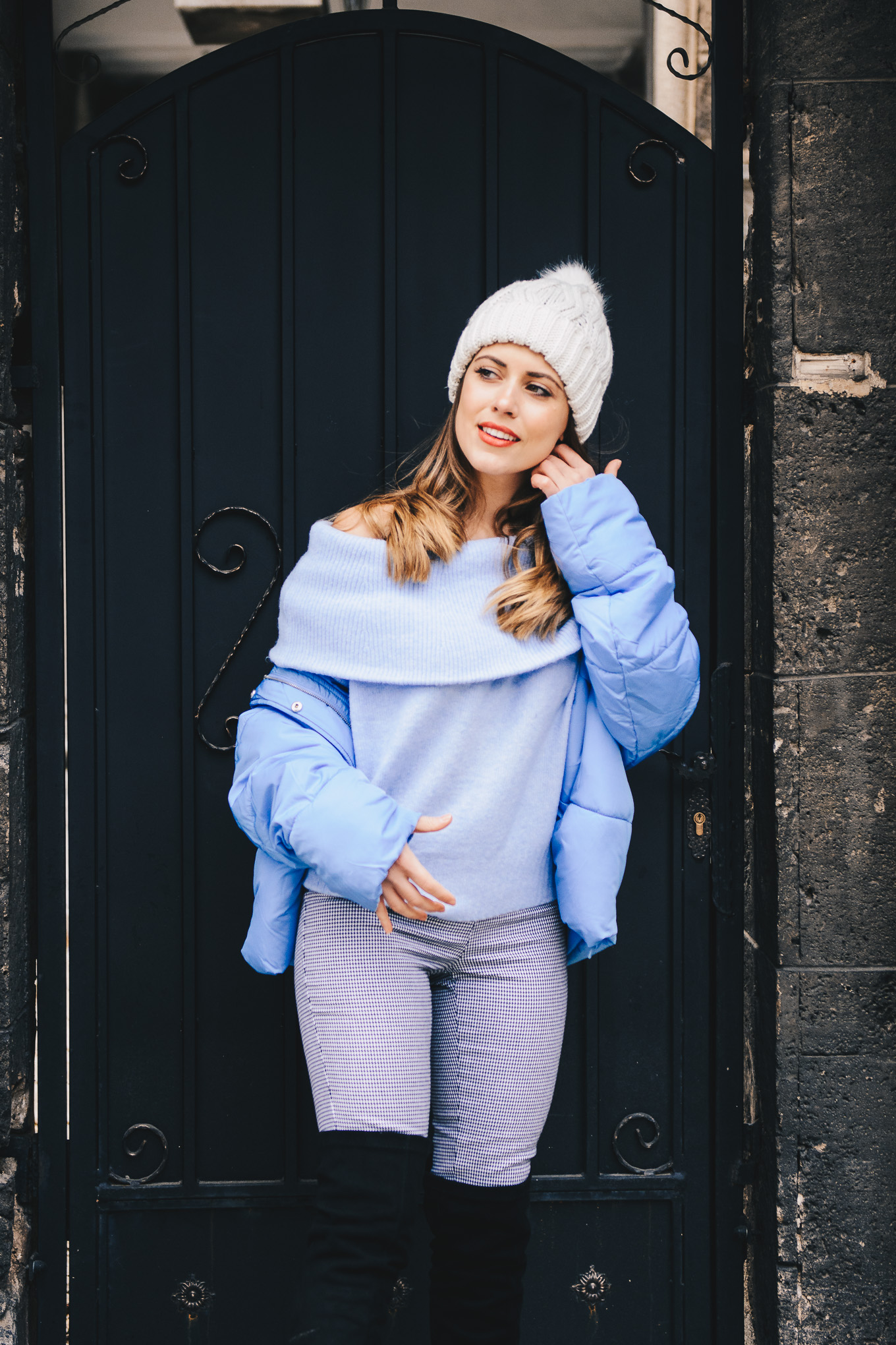 Style blogger wearing blue puffer jacket