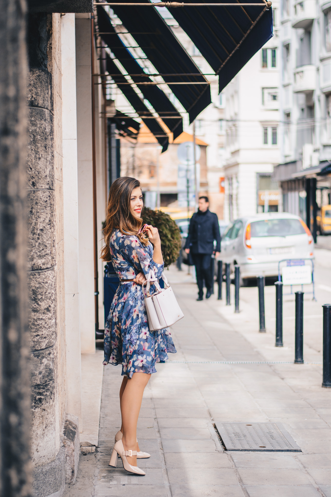 Fashion blogger in floral dress