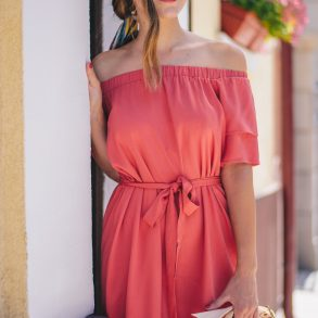 The red off the shoulders dress