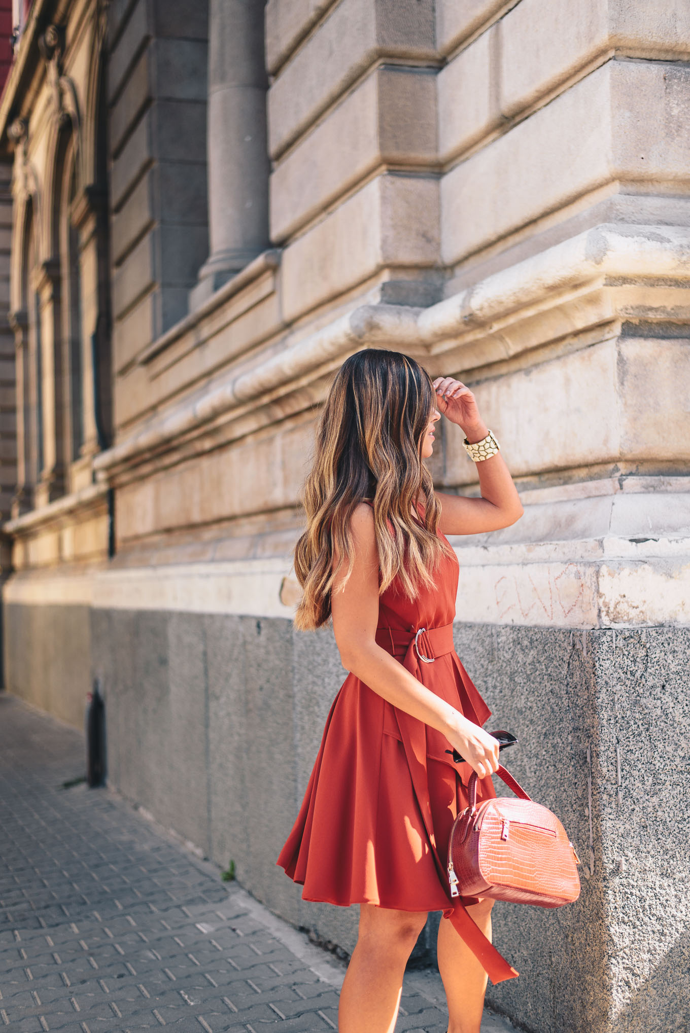 wearing a red dress in the city