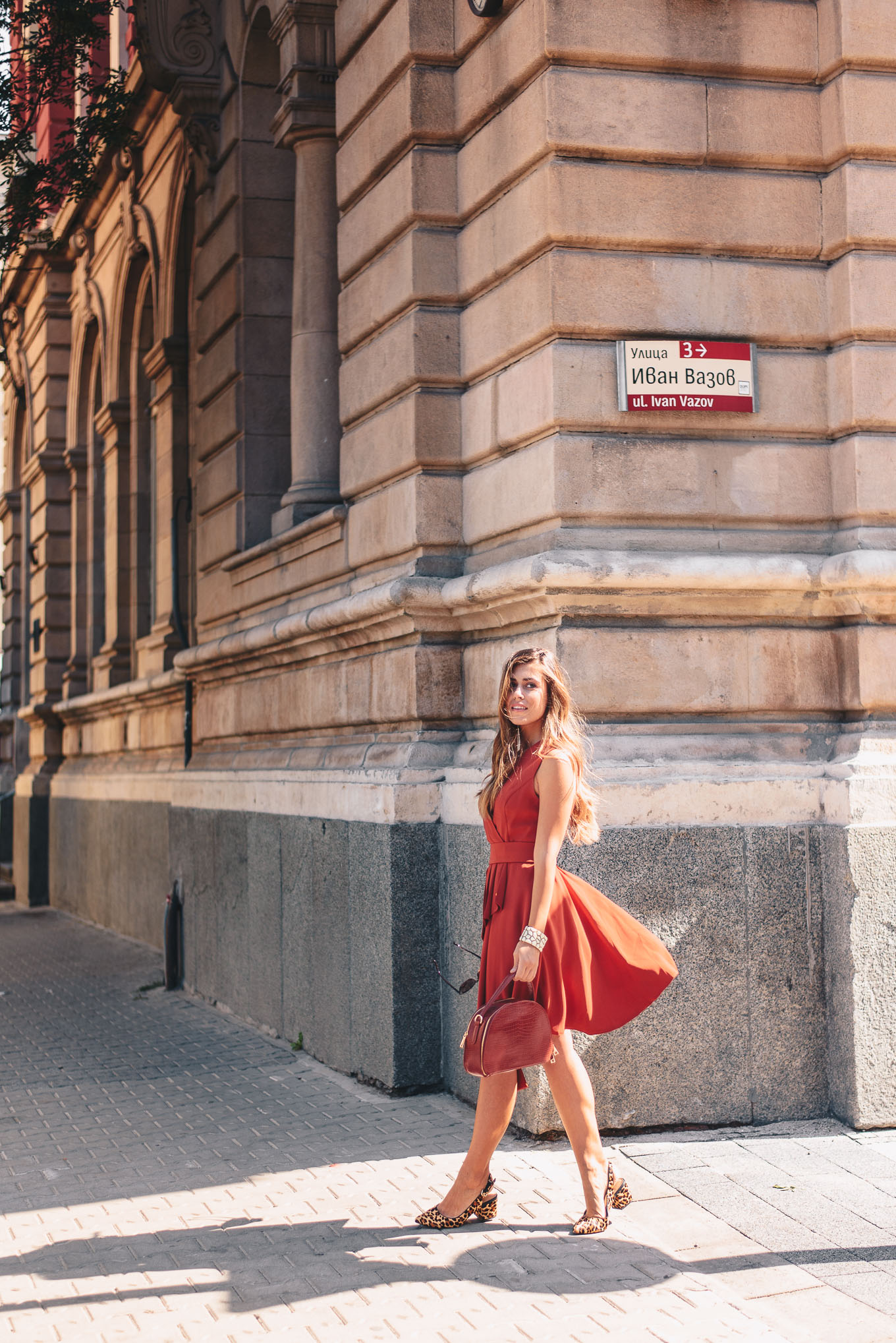 Walking down the street in a red dress
