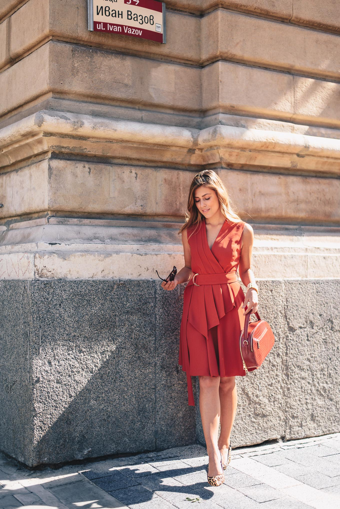 pop of red dress in the city